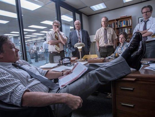 "From left, Tom Hanks (Ben Bradlee), David Cross (Howard Simons), John Rue (Gene Patterson), Bob Odenkirk (Ben Bagdikian), Jessie Mueller (Judith Martin), and Philip Casnoff (Chalmers Roberts) in ""The Post."""