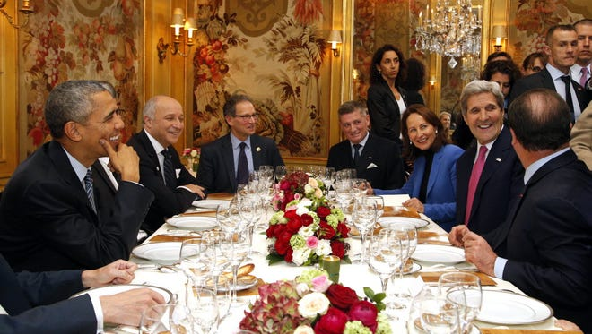 President Obama, Secretary of State John Kerry, right, and other leaders dine in Paris on Nov. 30, 2015.