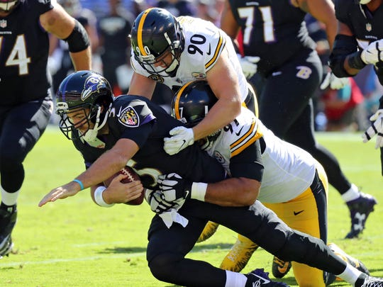 Baltimore Ravens quarterback Joe Flacco  sacked by