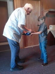 Bill Master, of Elmdale Baptist Church, shows Will