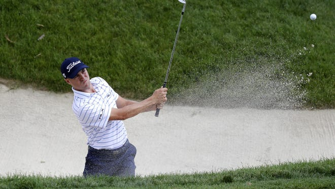 Justin Thomas hits from the 16th bunker during the third round of the Workday Charity Open on Saturday in Dublin, Ohio.
