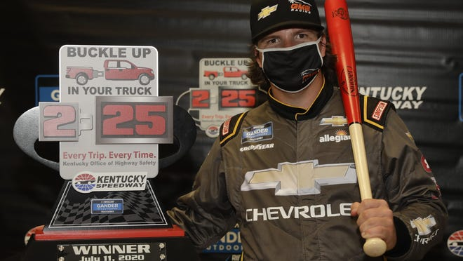 Sheldon Creed poses with the trophy after winning a weather shortened NASCAR Truck Series race Saturday in Sparta, Ky.