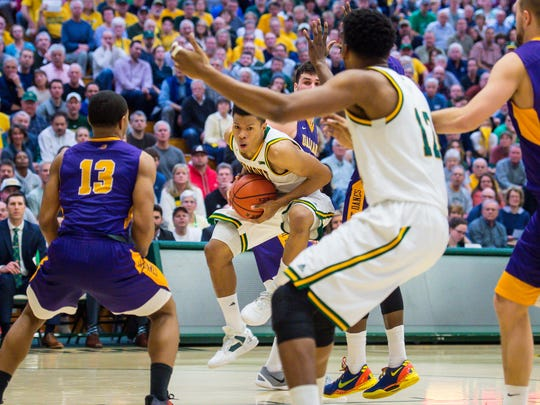 The University of Vermont's Trae Bell-Haynes pulls down a rebound against the University of Albany in Burlington on Wednesday, February 22, 2017.