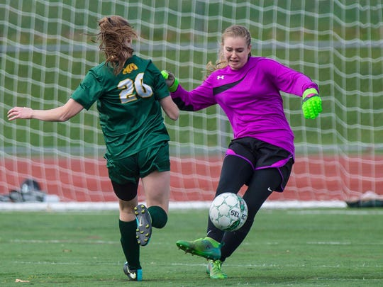 Champlain Valley Union's Maryn Askew, right, keeps