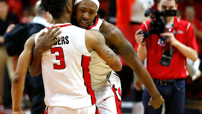 Rutgers Scarlet Knights guard Corey Sanders (3) and  forward Deshawn Freeman (33) celebrate after defeating Illinois Fighting Illini 62-59