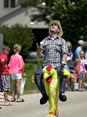 Juggler Ryan Duescher takes part in the Chickenfest parade in 2016.