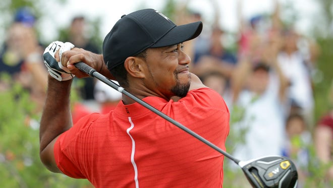Tiger Woods watches his tee shot on the first hole during the final round at the Hero World Challenge on Dec. 4, 2016, in Nassau, Bahamas.