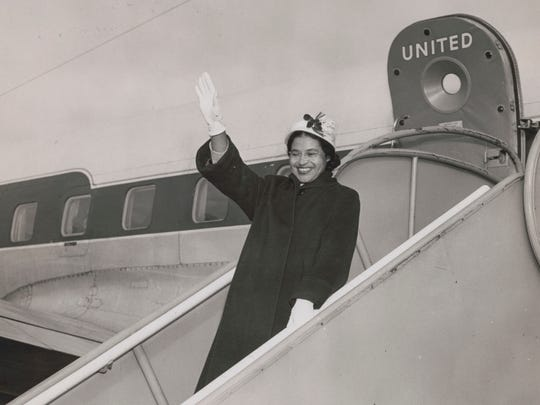 Rosa Parks waving from a United Air Lines jetway in