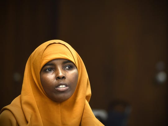 Inman Abdullah talks about her experiences during a group meeting of Somali students May 28 at Tech High School.