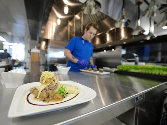 Chef De Cuisine Bobby Wrobleski prepares recipes that will be taught to kitchen staff Monday at The Cannery on Broadway.
