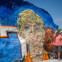 Allison Riddle, Rachel Shanks, and Jan Bible, all of Greenville, N.C., pause for a photo in front of The Rock before a Celebration of Life service for the late Lady Vols basketball coach Pat Summitt on Thursday, July 14, 2016, at the University of Tennessee. Summitt, the winningest coach in Division I college basketball history, died June 28 of early onset Alzheimer's disease. She was 64.
