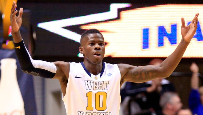 West Virginia's Eron Harris (10) celebrates a 3-pointer late in the second half during an NCAA college basketball game against Virginia Tech in Morgantown, W.Va., on Saturday, Dec. 8, 2012.