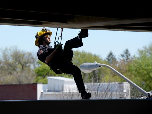 RCHBrd_05-04-2015_RCH_1_A001--2015-05-03-IMG_firefighters_garage._1_1_POAL1M