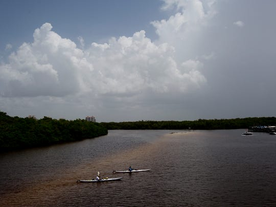 Paddlers make their way across Hickory Pass in Bonita Springs last Sunday.