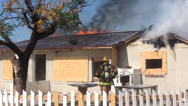 Phoenix fire crews battled a fire at an abandoned home on Oct. 27, 2014.