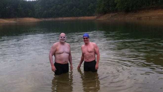 Roberson swimming coach Jim Cottam, left, and Dave Easterling.