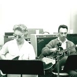 """Carol Kaye, wearing sunglasses to help her read the charts in a harshly lit studio, and Bill Pitman get ready to record. Kaye, who is best known as a bass player, started out as a jazz guitarist. She is not a fan of the new music doc """"The Wrecking Crew."""""""