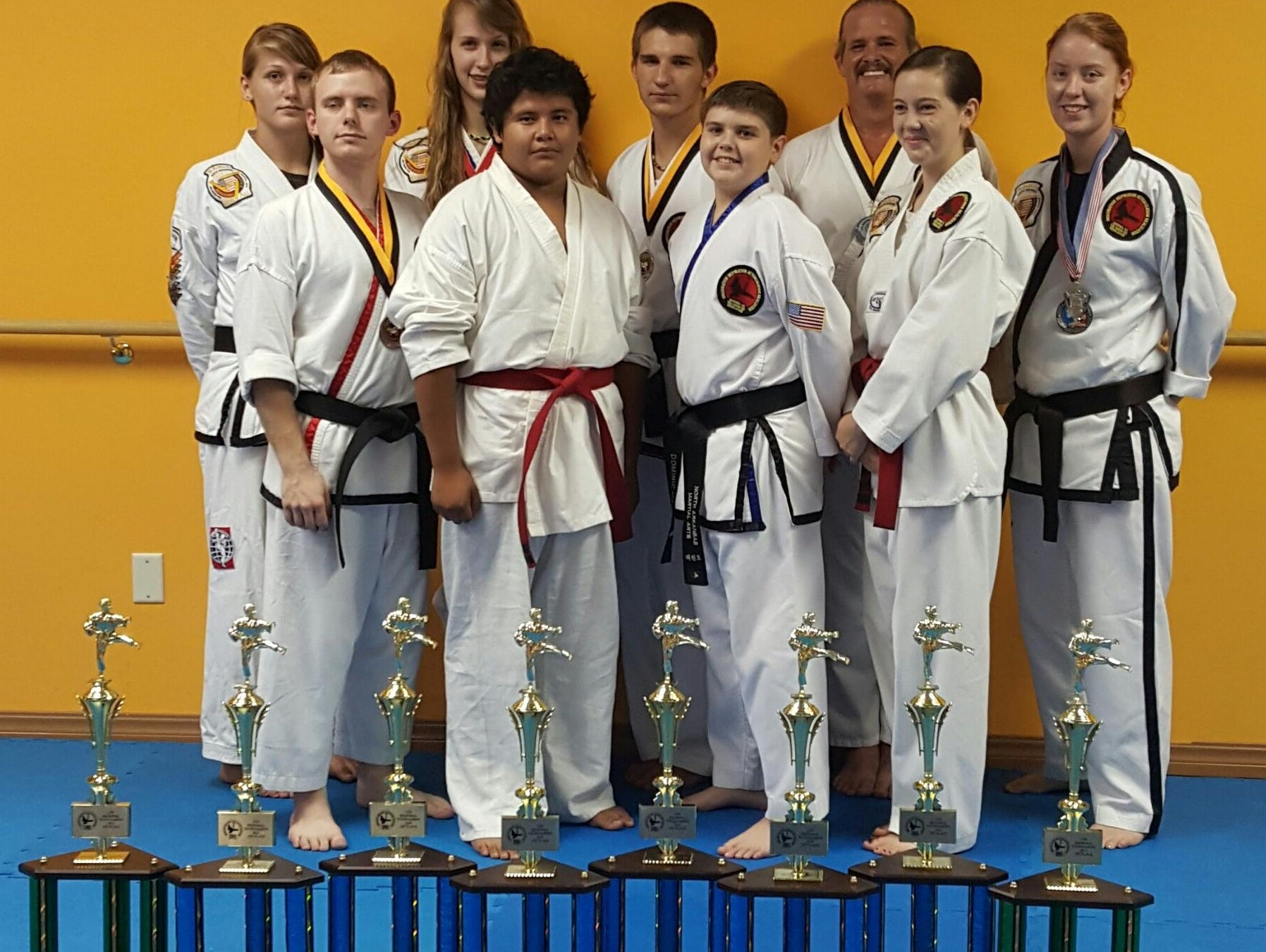 Members of North Arkansas Martial Arts display the eight first-place trophies they won at a recent tournament in Mt. Juliet, Tenn.