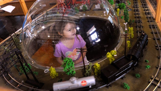 Lydia Wright, 3, watches the model trains roll by from inside a Plexiglas dome at the Martin & Frances Lehnis Railroad Museum in Brownwood Thursday July 20, 2017. The museum held its first Model Train Camp last week.