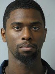 Deshawn Chase, 27, has been charged with carrying heroin and a stolen gun.