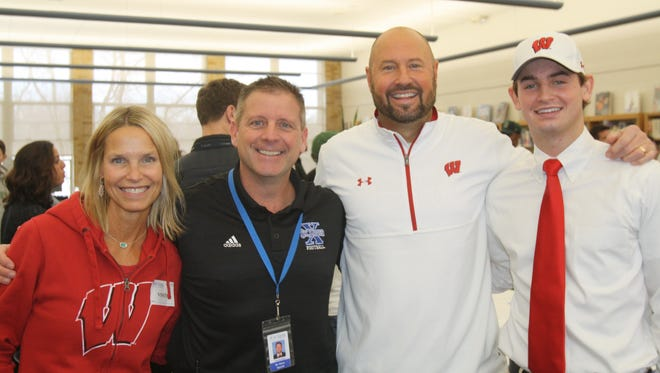 Chase Wolf participated in St. Xavier's signing day ceremony on Thursday, Feb. 8, 2018. Wolf signed to play football at Wisconsin. Pictured here with his mom, Jeanne, St. Xavier head coach Steve Specht, and his dad, Steve.