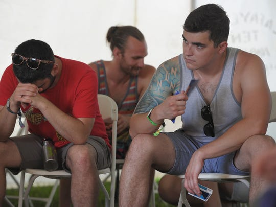 Festival attendees participate in a group meeting at the Soberoo tent at the Bonnarro Music and Arts Festival on Friday June 12, 2015, in Manchester, TN.