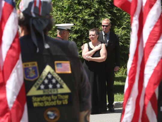 Marine honor guard carries the flag draped coffin