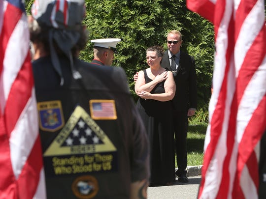 Marine honor guard carries the flag draped coffin of U.S. Marine Corps Gunnery Sgt. Brendan Johnson from a hearse outside McHoul Funeral Home on Rt. 52 in Fishkill after arriving from Dover Air Force Base July 26, 2017. Johnson was among 15 Marines and one Navy corpsman killed when the aircraft they were in crashed in Mississippi. Pictured is wife Anna Johnson.