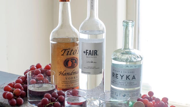 An assortment of vodkas from left to right, Tito's Handmade, Fair Quinoa and Reyka in Concord, N.H. on June 30, 2014.
