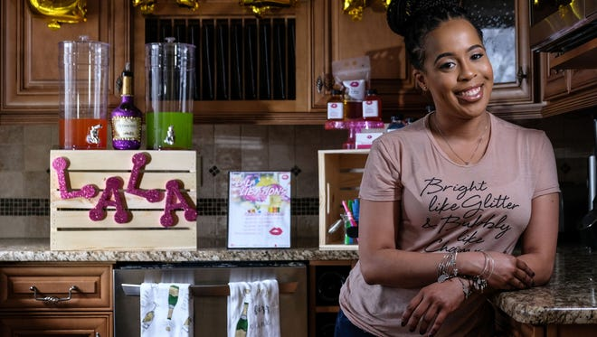 LaTondra Cannon of Southfield, owner of Ooh La La! Bartending Services, poses in the kitchen of her home on Friday March 9, 2018.