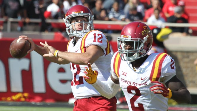 Iowa State Cyclones quarterback Sam Richardson (12) drops back to pass against the Texas Tech Red Raiders in the first half at Jones AT&T Stadium.
