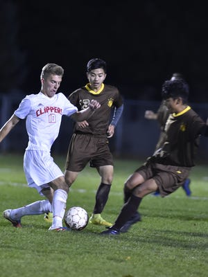 Sturgeon Bay's Jaden Stevenson, left, leads with the ball against Saint Lawrence Seminary's Abraham Sanchez and Cristian Estrada, right, during the second half of a WIAA Division 4 sectional semifinal game last week at Sturgeon Bay.