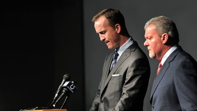FILE - Indianapolis Colts quarterback Peyton Manning pauses as he starts to tear up while owner Jim Irsay listens after it was announced that the Colts are letting go of Manning after 14 years during a press conference March 7, 2012.