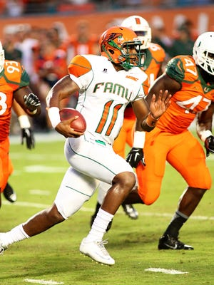 FAMU quarterback Damien Fleming, center, says he wants his offense to strike early and often against TSU.