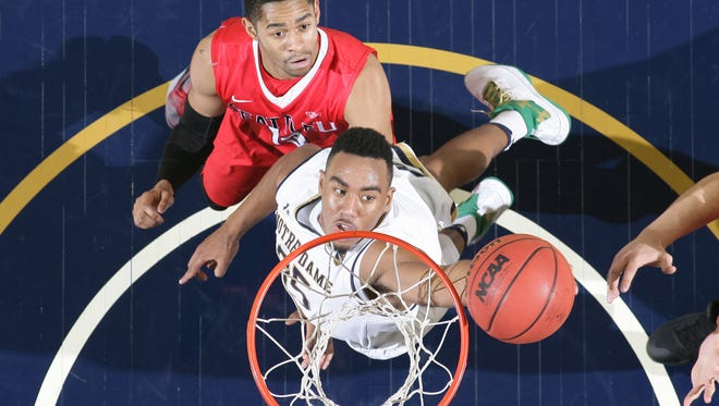 Notre Dame Fighting Irish forward Bonzie Colson (35) shoots the ball in front of Seattle Redhawks forward Emmanuel Chibuogwu (13) in the second half at the Purcell Pavilion. Notre Dame won 92-49.