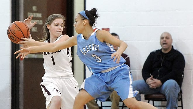 Bishop Kearney's Rosa Graham, right, reaches to tip the ball from Aquinas' Danielle Antonio during a regular season game played at Aquinas Institute on Wednesday, January 15, 2014.  Bishop Kearney beat Aquinas 65-39.