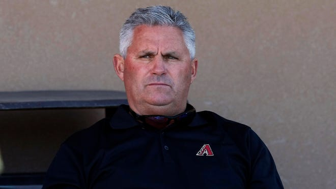 Diamondbacks executive vice president & general manager, Kevin Towers looks on during camp at Salt River Fields.