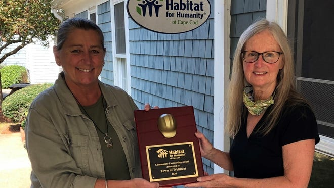 Wendy Cullinan, left, executive director of Habitat for Humanity Cape Cod, presents Elaine McIlroy, chairwoman of the Wellfleet Housing Authority, with the Community Partner Award for 2020. McIlroy accepted the award on behalf of the town of Wellfleet.