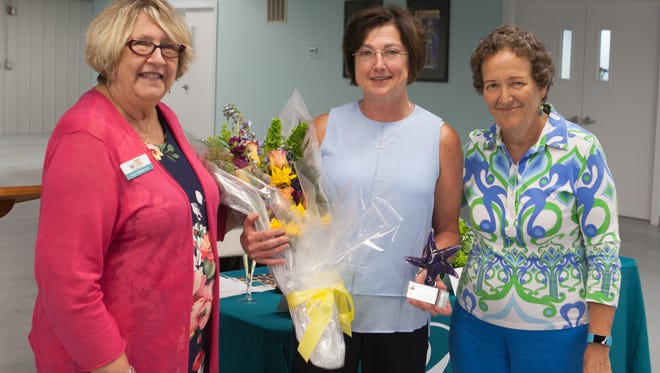 Suzy Hutcheson, Kathy Skrzypczak and Bliss Browne at Helping People Succeed's Annual Meeting. Skrzypczak is the group's outgoing Chairperson.