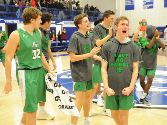 Novi's Austin Mackay lets out a yell after winning