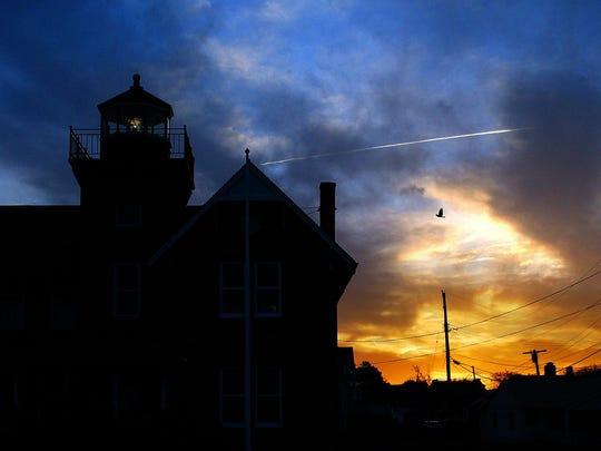 The light at the Sea Girt Lighthouse begins to shine at sunset.