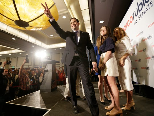 Florida Republican Sen. Marco Rubio acknowledges the cheers from supporters after winning a second term in office, Tuesday, Nov. 8, 2016, in Miami. Rubio defeated U.S. Rep. Patrick Murphy, a two-term congressman.