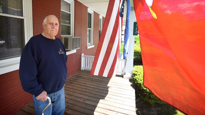 Korean War veteran George Yocklovich, of Cornwall, proudly flies the American flag between the red U.S. Marine Corps flag and a blue flag honoring those who fought at the Battle of Chosin Reservoir.