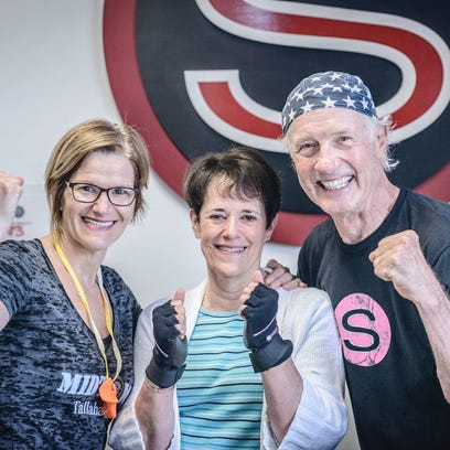 Rock Steady Boxing coaches Kim Bibeau (right) who is
