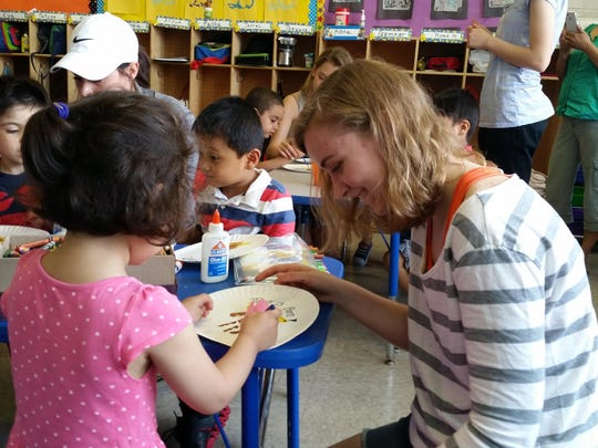 Anna Gottshall works with a young New Yorker during Vacation Bible School while on a mission trip to the city.