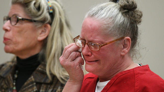 Rene Bailey, with attorney Adele Bernhard, becomes emotional during a hearing when she was freed.