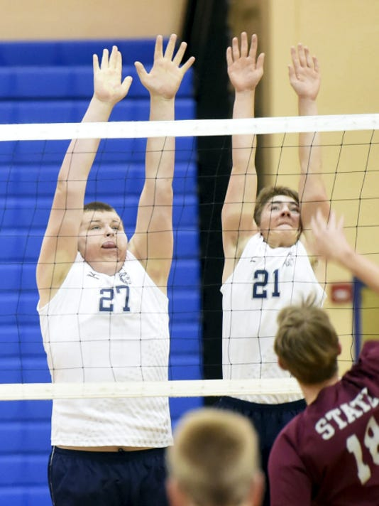 Bryce Whitfield, left, and Jacob Dagenhart, go up for a block in Chambersburg's JV match against State College.