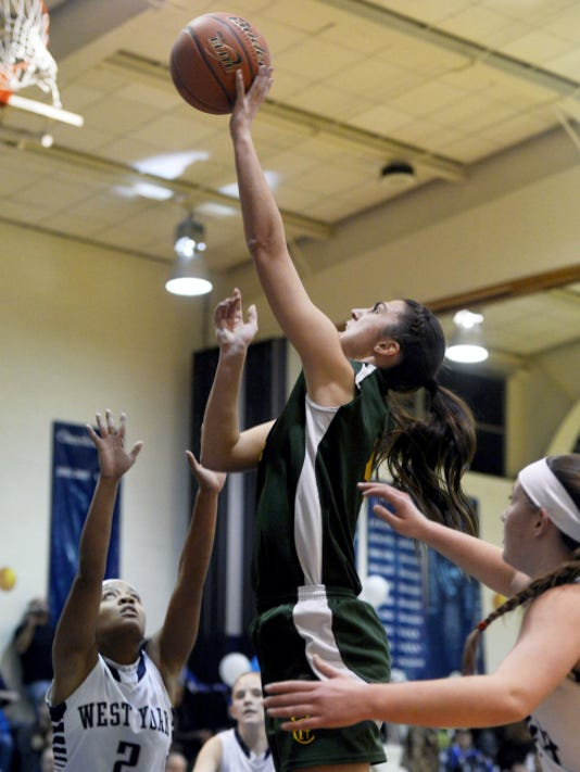 York Catholic's Hannah Laslo goes up for a shot against West York during a regular-season game. Laslo, who scored her 1,000 career point this season, has full schedule of extracurricular activities on her plate, from academics to volunteer work to music.