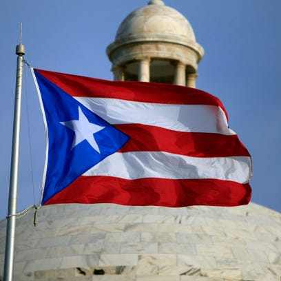 The Puerto Rican flag flies in front of Puerto Ricoís