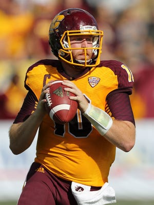 CMU senior and Lansing Catholic graduate Cooper Rush was picked up by the Dallas Cowboys as an undrafted free agent.